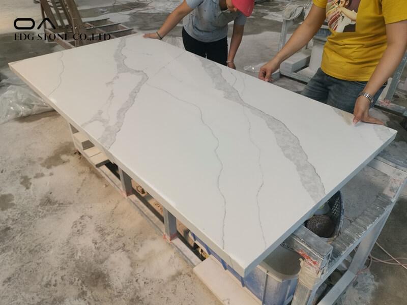 quartz countertops with honey oak cabinets