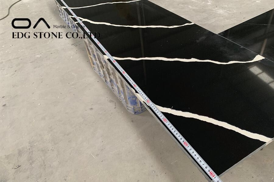 black quartz countertop with white veins